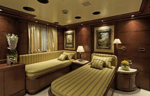Twin stateroom on board charter yacht O'MEGA