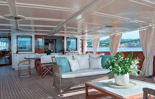 Dining set-up and alfresco lounge area on luxury yacht Haida 1929