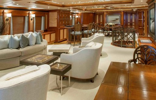 The dark oak fixtures and the cream furnishings featured on board superyacht UNBRIDLED