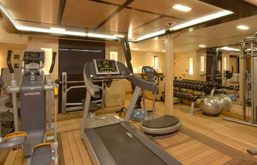 Fully equipped gym onboard yacht charter AMARYLLIS, with direct access to beach club area.
