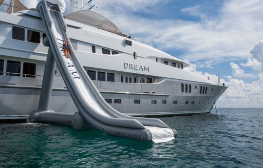 Slide on board luxury yacht DREAM with profile shot of charter yacht in background