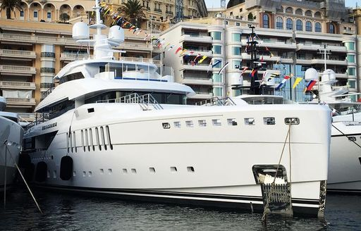 The profile of a white luxury yacht berthed in Monaco