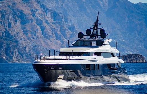 Blue superyacht cruising along Italian Coast