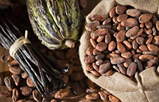 An assortment of coffee beans and fruit