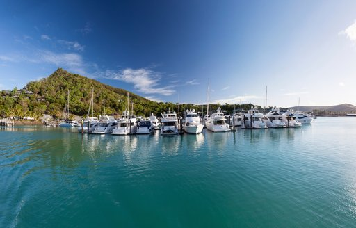 Yachts anchor in the serene, crystal clear waters of the Whitsunday Islands, Queensland, Australia