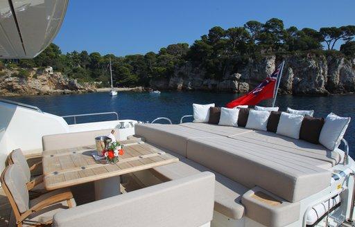 formal alfresco dining on aft deck of superyacht FIRECRACKER