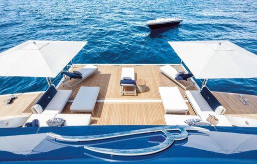 view over swim platform and parasols on board superyacht lady jorgia