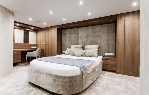 master suite with earthy hues on board charter yacht Timeless