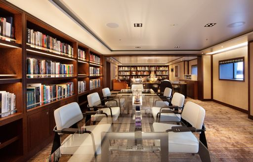 motor yacht planet nine conference room with bookshelves