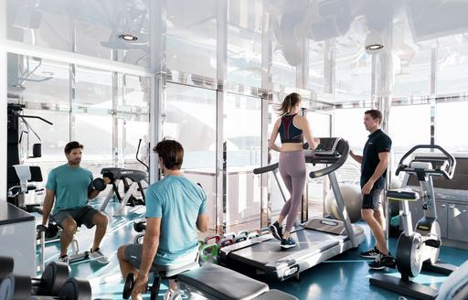 Charter guests do fitness programme on board luxury yacht