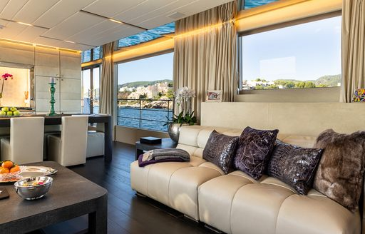 Sofa and chairs in main salon of motor yacht Cinquanta 50