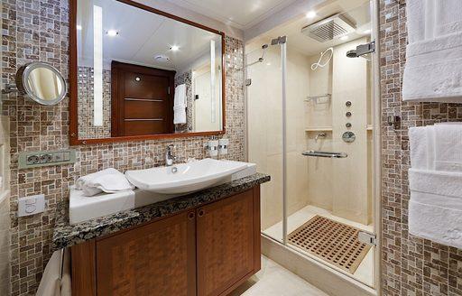 contemporary en suite bathroom in master suite aboard sailing yacht DAIMA