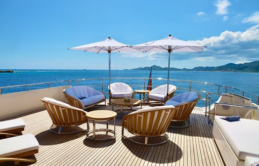 Shaded seats and table on deck on superyacht LIONSHARE