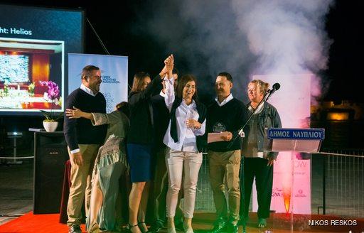 Motor yacht HELIOS accepting their award at the Mediterranean Yacht Show 2016