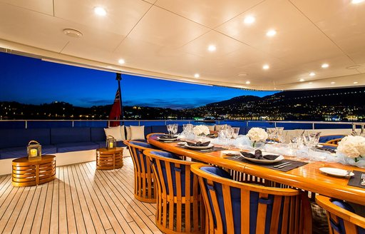 alfresco dining at night on board superyacht MISCHIEF