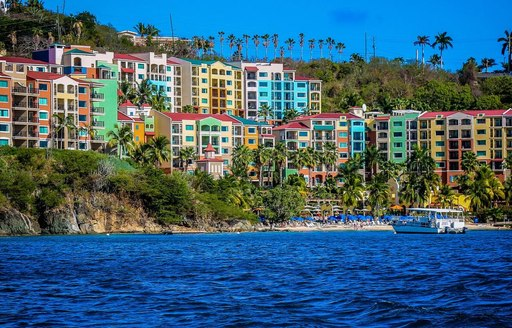 A collection of vibrantly painted buildings close to the coast of St Thomas