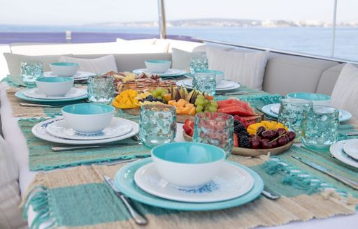 Aft dining table set for breakfast onboard MY Free Soul