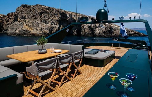 luxury yacht cant remember sundeck with backdrop of greek scenery