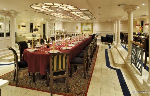 Formal dining salon on superyacht Christina O