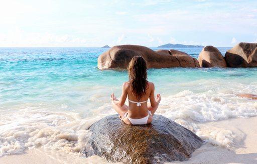 Meditation on a beach in Seychelles