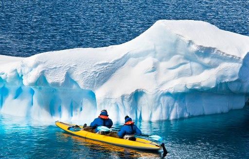 kayaking in antarctica, alongside glacier