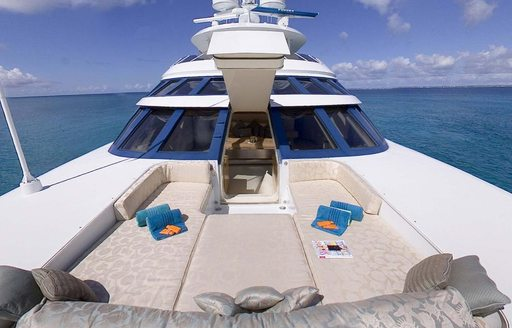 Foredeck sunpads connected to main cabin on charter yacht AZZURA II