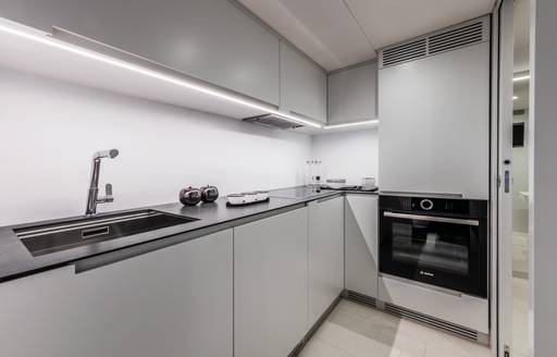Galley area on motor yacht BEYOND, sink and cooker visible