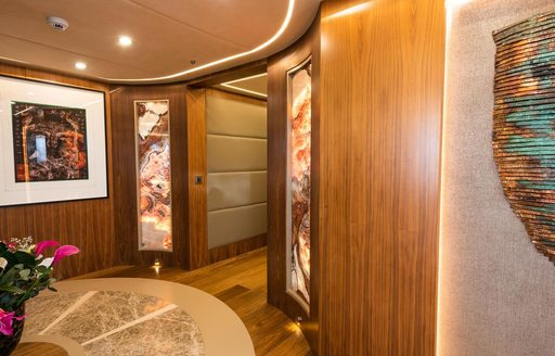 Corridor on luxury sailing yacht ARESTEAS, with pictures on walls