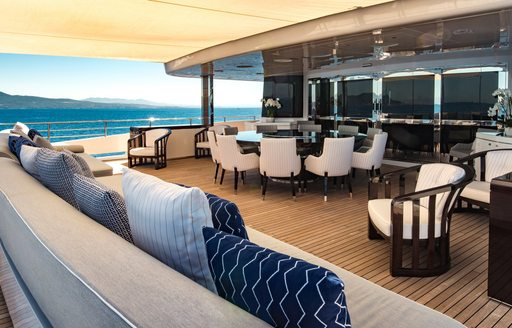 Comfortable seating areas and tables on deck of superyacht RARITY