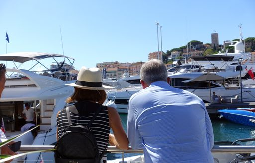 Attendees at cannes yachting festival 2019 enjoying the sun