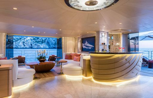 Side balconies in beach club of motor yacht Here Comes the Sun