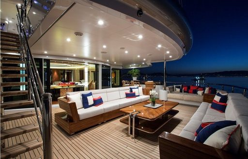 An outdoor lounge featured on board a superyacht