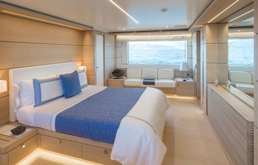 master suite with oak panelling and large windows aboard superyacht NARVALO