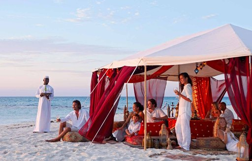 people dining in tent on the beach on thanda island