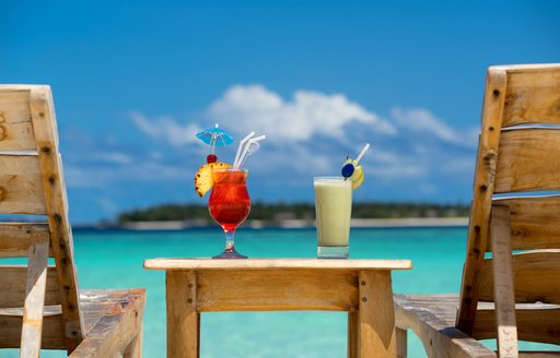 cocktails in the bahamas, tropical fruit drinks overlooking blue sea