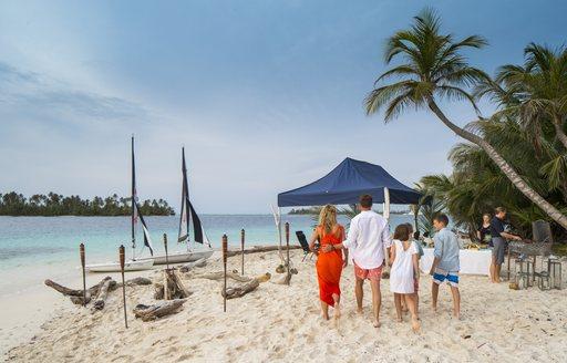 luxury yacht beach picnic set up