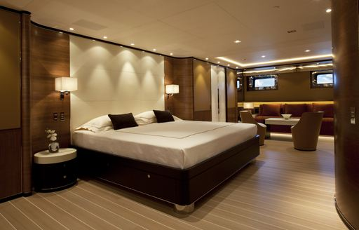 full-beam master suite with seating area on board luxury yacht FIDELIS