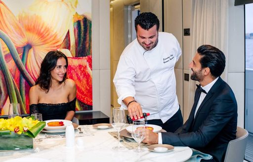superyacht chef serves his diners on luxury yacht