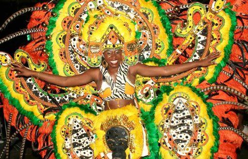 female dancer in colourful Full-body cardboard costume at junkanoo