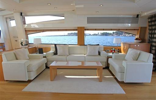 lounge area in main salon of charter yacht FIRECRACKER