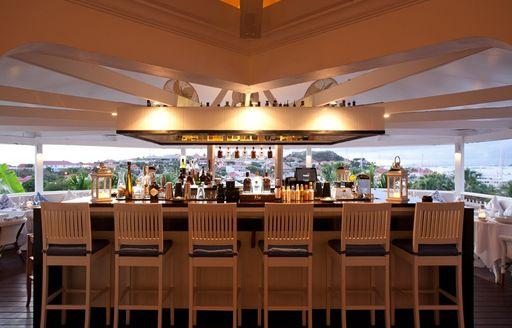 Bar stools surrounding the bar at Bonito restaurant