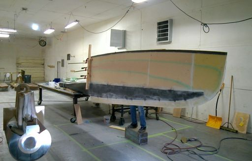 Man works on new keel and rudder for sailing yacht Axia