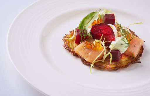 Fine dining cuisine on white plate on board motor yacht
