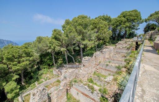 Walls and trees on the border of Villa Jovis in Capri