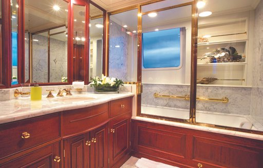 sumptuous and sophisticated His-and-hers bathroom inside the master deck of charter yacht Lady J