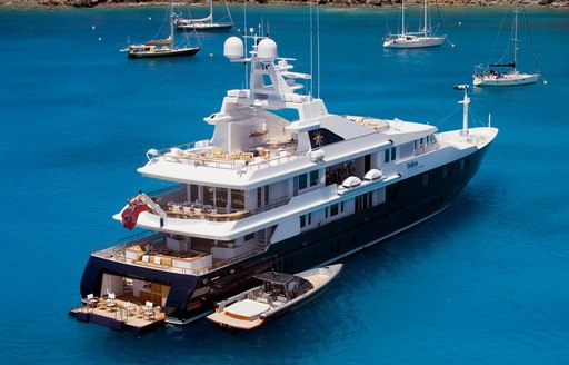 superyacht Helios anchors on a Caribbean yacht charter and opens up beach club