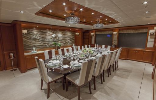 The formal dining area of motor yacht SKYFALL