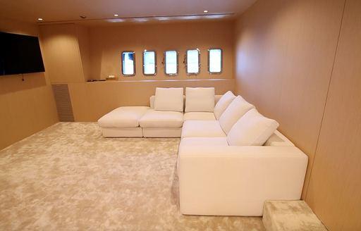 Sofas and TV on charter yacht NEOPRENE