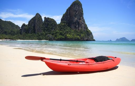 red boat shore in Thailand