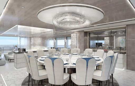 circular dining table in the main salon of superyacht GO